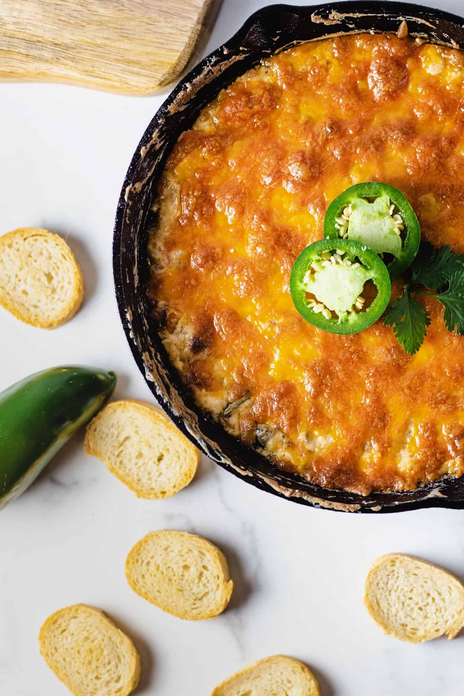 Overhead shot of jalapeno popper dip in a cast iron pan