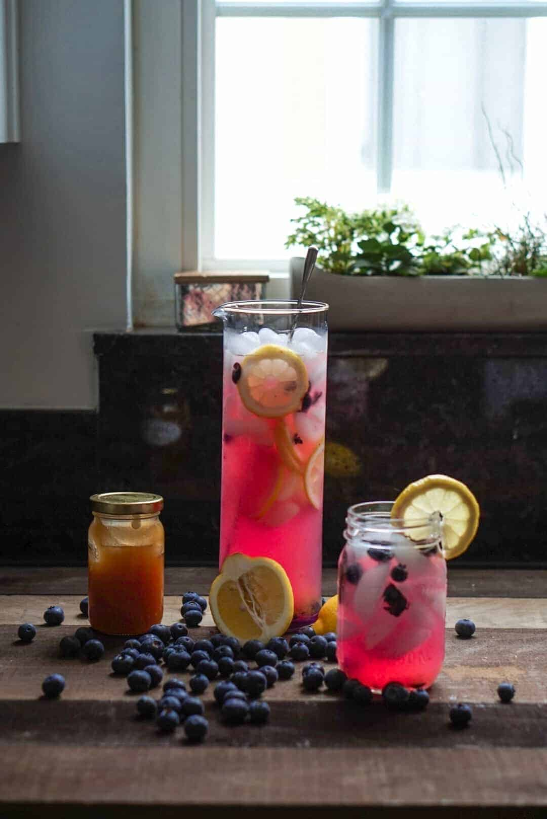 Pitcher and 2 glasses of fresh-squeezed blueberry lemonade