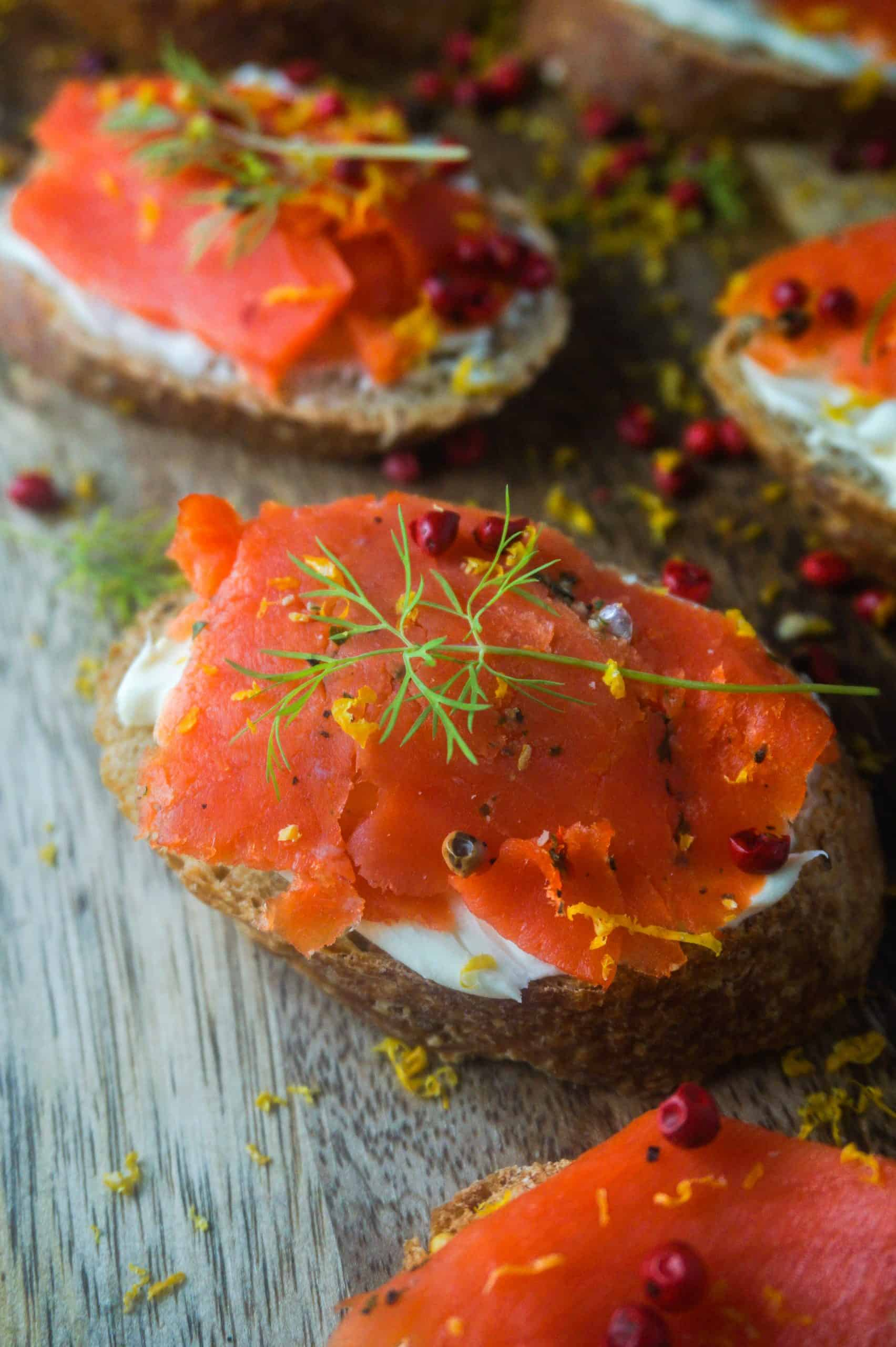 One crostini with smoked salmon, dill, lemon and pink peppercorns
