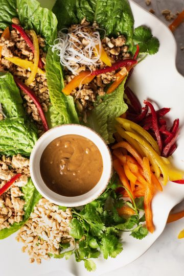 chicken lettuce wraps close up with peanut sauce