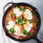 Over head shot of Shakshuka recipe with eggs and jalapeño