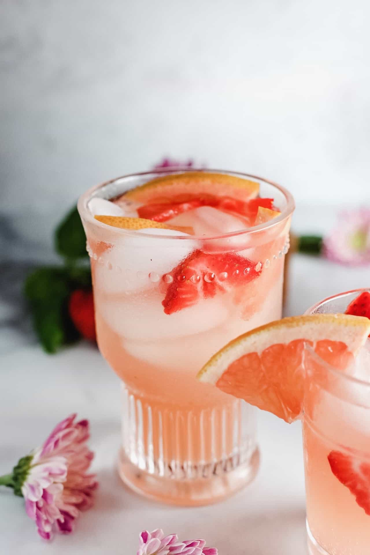Single glass of grapefruit strawberry white sangria
