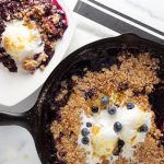 Cast iron pan and plate with crumble, ice cream and sauce