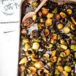 Sheet pan and dish towel with roasted brussels sprouts