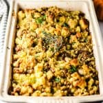 Cornbread with sausage in baking pan with herbs