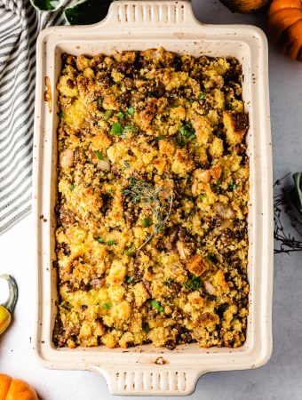 Stuffing in baking dish with fresh thyme and parsley