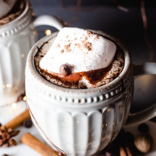 Mug of hot chocolate with chai spices and marshmallows