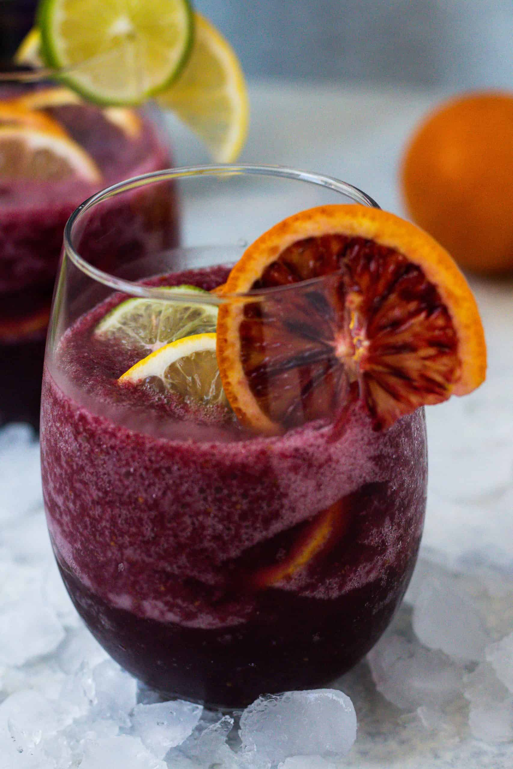 stemless wine glass with red sangria and fresh fruit with crushed ice